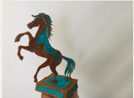 3D printed brown and blue horse trophy