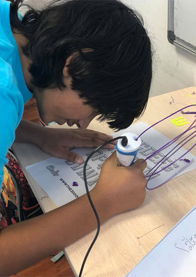 Young boy practicing 3D drawing exercise at Premier Genie STEM camp