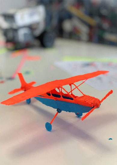 3D Drawn orange and blue small aircraft at Premier Genie STEM camp